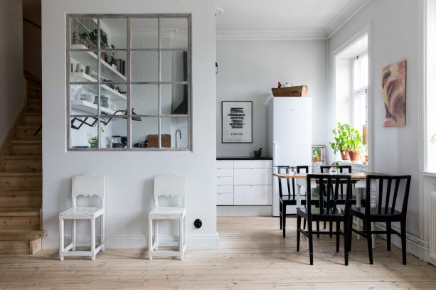a more open feeling in the small kitchen with glass window