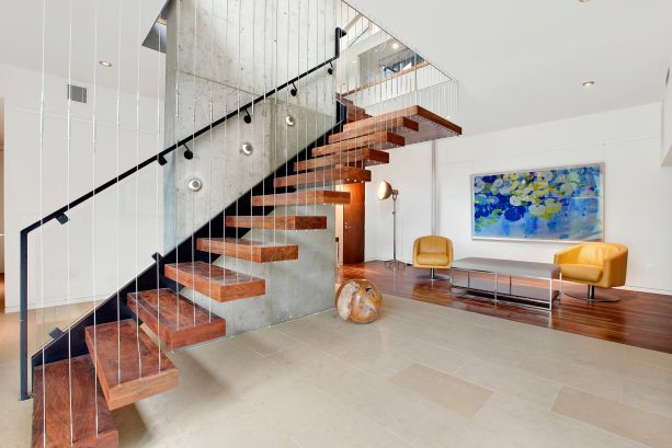 a very unique semi-floating open staircase to basement with combination of glass and cable balusters