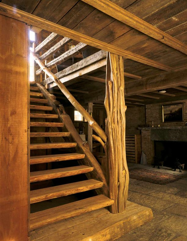 an open staircase from natural wood material