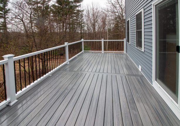 home exterior with grey siding and grey-stained deck color