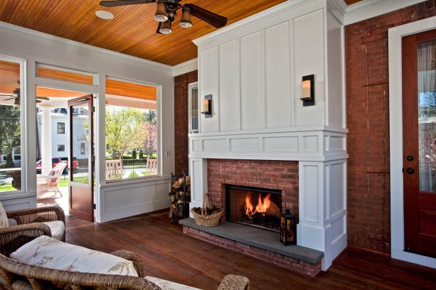 a timeless-looking screened porch fireplace with wainscoting
