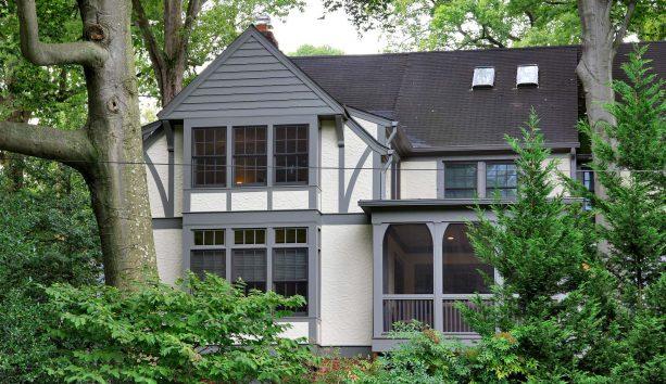 ivory-white stucco exterior with dark, bold grey trim