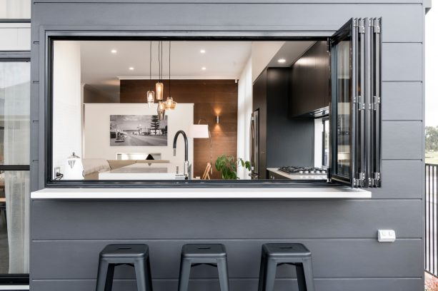 a black pass through window looks stunning with white counter