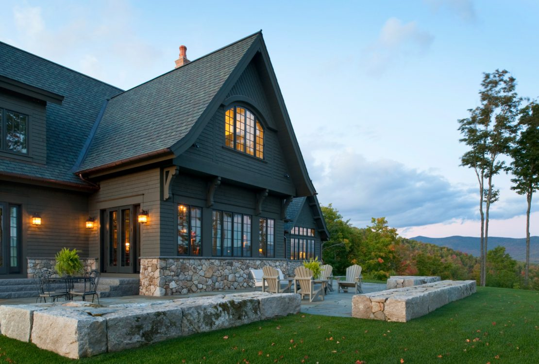 a gorgeous dark brown house looks like it belongs to the mountain area