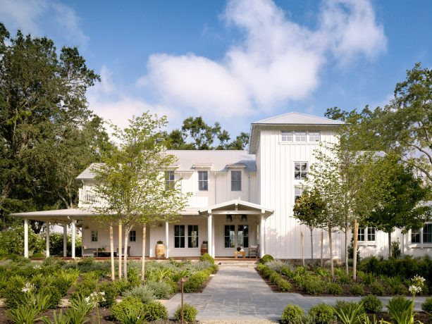 a beautiful two-story farmhouse residence with China White OC-141 color