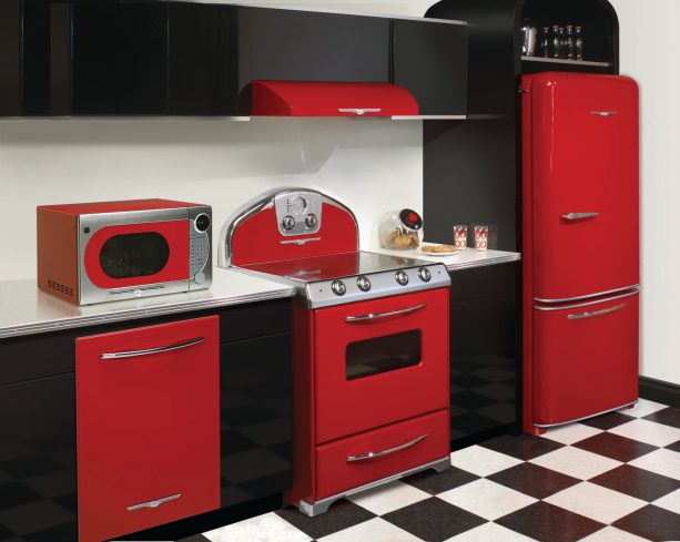 a set of red retro appliances for easy decorating in a black and white kitchen interior