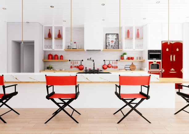 a white kitchen looks stunning with the addition of red and black dining chairs in director-style
