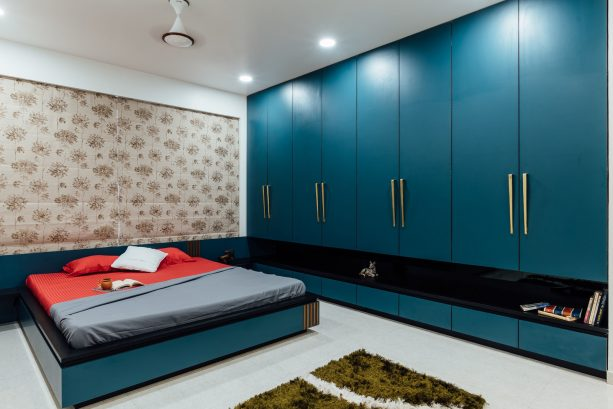 an Asian-style bedroom with fascinating custom teal and black furniture pieces