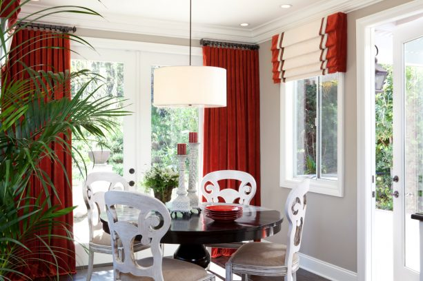 an elegant, luxurious kitchen nook with black, white, and red color theme