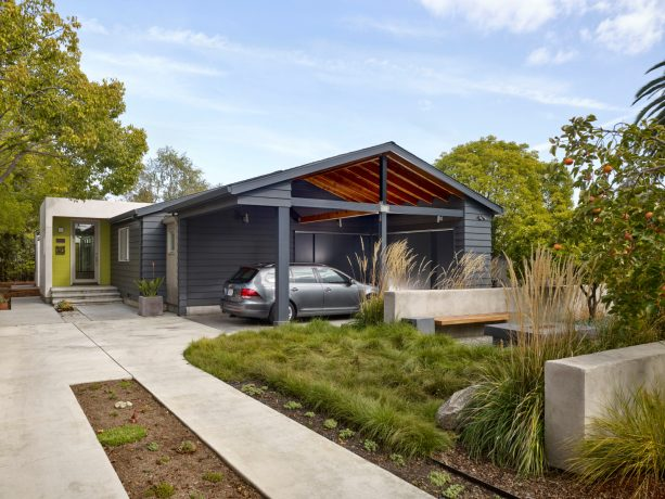 a modern, attached carport looks masculine because of its charcoal grey color