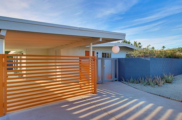 an attached carport completed with a gate for extra protection and privacy