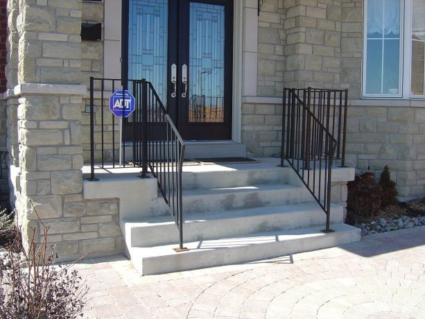 a front concrete steps looks ordinary before the makeover