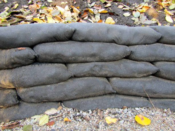 an image of concrete retaining wall after the bags are degraded after some time