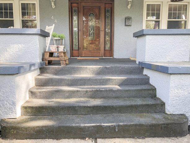 the carpeted concrete front steps looks outdated before the makeover