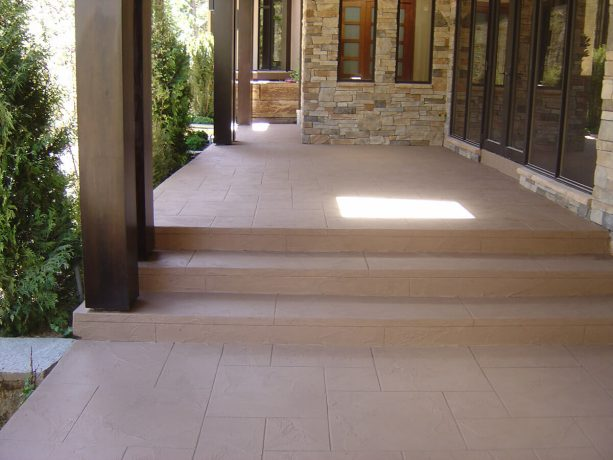 the concrete steps after resurfacing, coloring, and stamping makeover