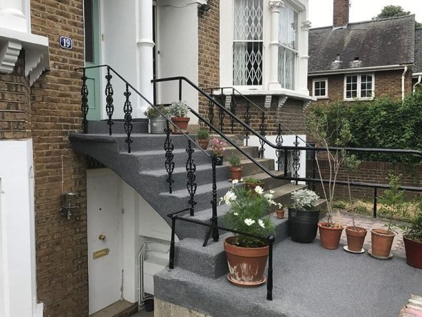 the repairing and resurfacing process of the front concrete steps using plaster mortar