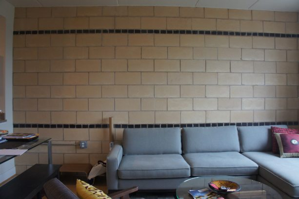 the wall before getting painted with charcoal grey paint
