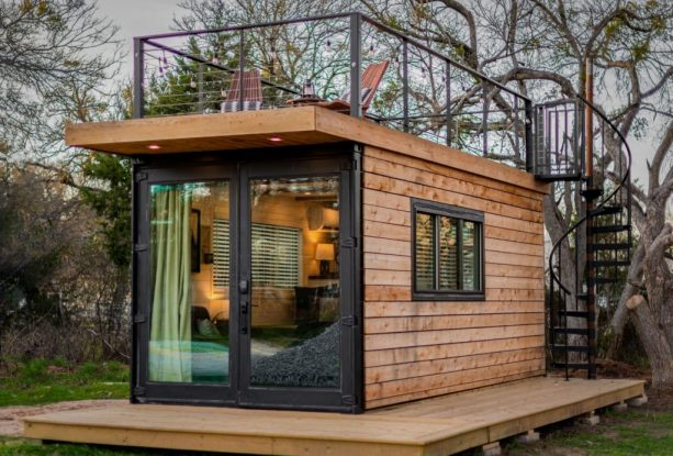 a super tiny house with roof deck with spiral staircase