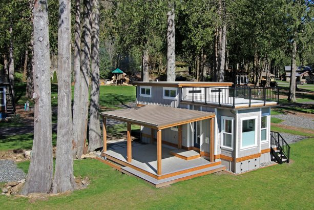 gorgeous grey and wood craftsman tiny house with roof deck and covered porch