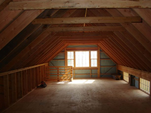 the interior of the loft completed with some windows