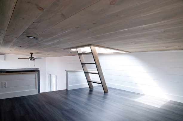 the ladder in the bedroom to access the roof deck