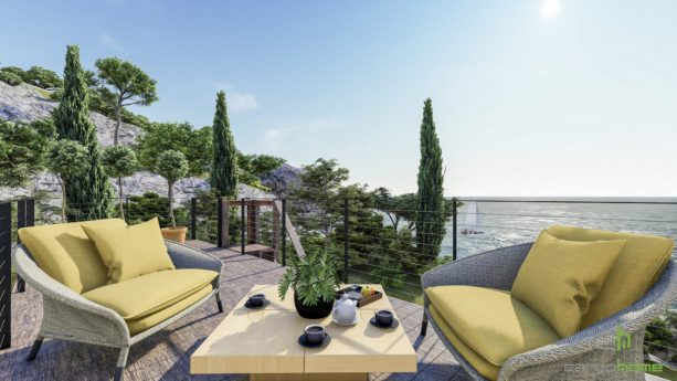 the roof deck comes with cozy furniture choices and an amazing ocean view