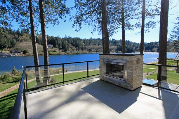 the roof deck with fireplace is perfect for enjoying the lake view