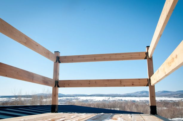 the wooden rail increase the safety value in the roof deck area