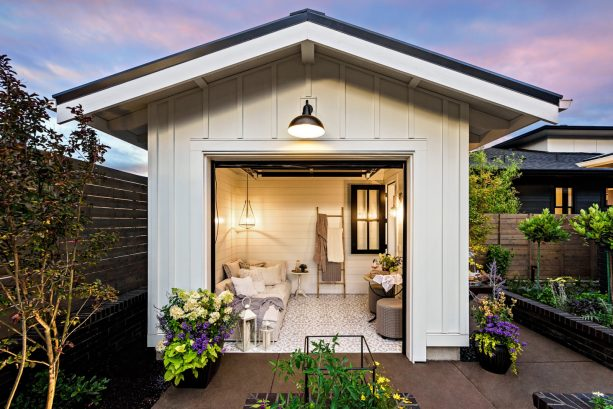 a small farmhouse shed with sectional garage door functioned as a guest room