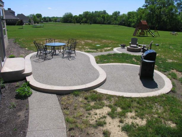 an exposed aggregate look in a traditional multi-level concrete patio and walkway