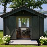 greyish brown writing and workshop studio shed with double sliding door garage door