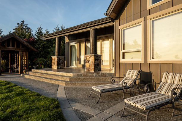 loungers make a concrete patio with exposed aggregate excellent for enjoying the sun